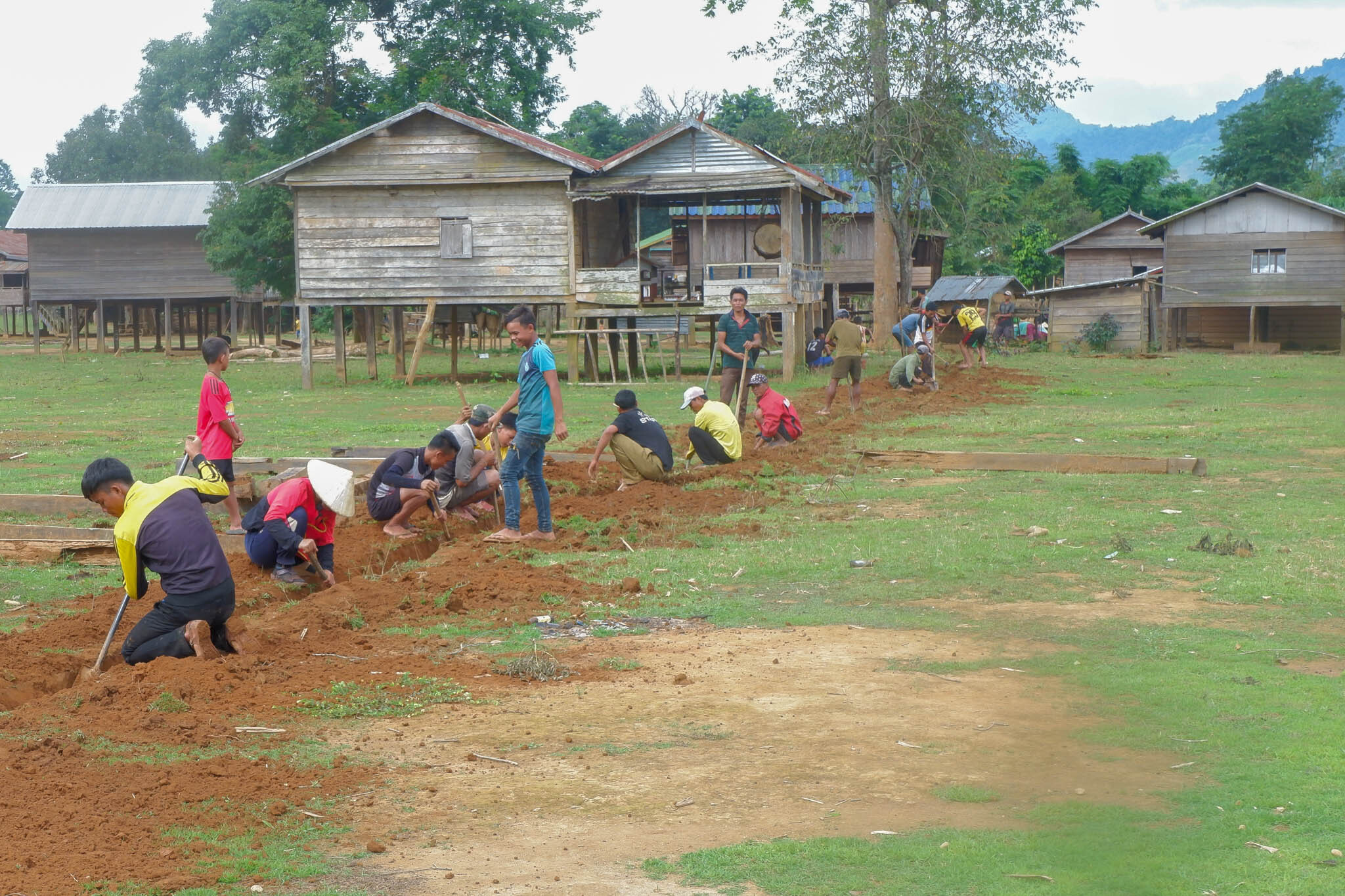 Power_Blox_Village_Electrification_Lao_Off_Grid_People_Digging_Cable_Trenches